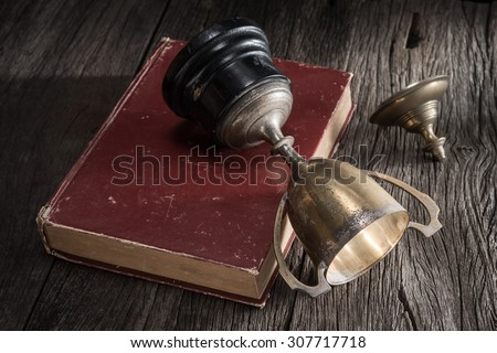 still life photography : old trophy tumble on old book in abandon concept