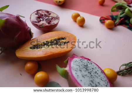 Still life photography with flowers and fruits