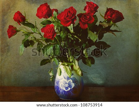 still life: red roses in vase on a grunge background - stock photo
