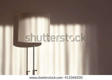 Still life room standing lamp with shadows and place for text.