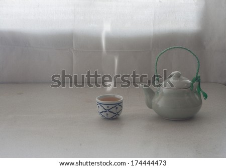 still life set of chinese tea pot with tea cup in warming day