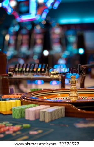 still life shot at a roulette table with no one around - stock photo