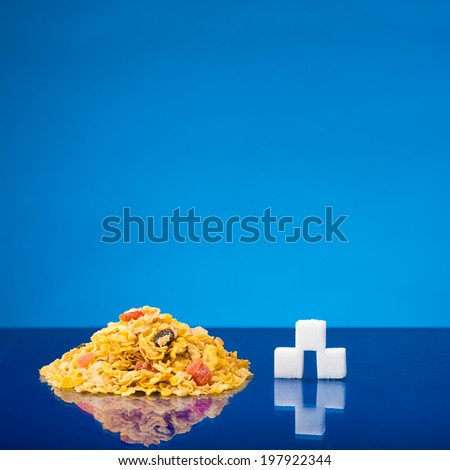 Still life showing amount of sugar in a portion of cereals - stock photo