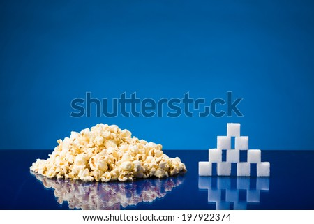 Still life showing amount of sugar in a portion of popcorn - stock photo