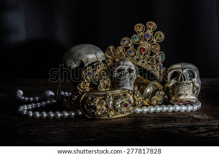 Still life Skull with Treasure Gold jewelry, pirate concept. - stock photo