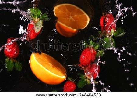 Still Life - splashing water on black background   - stock photo