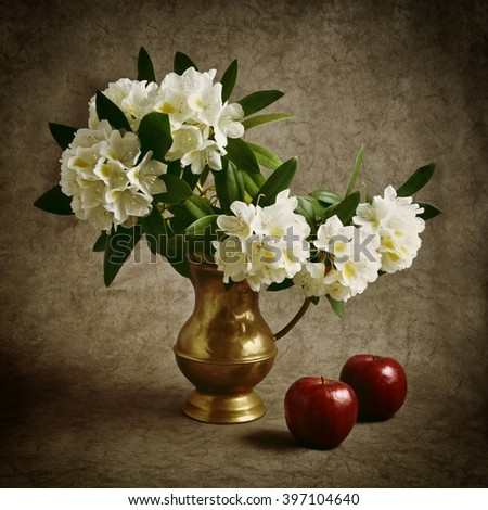 Still life.Still life with flowers - white rhododendron.Still life with flowers and red apples.Still life with flowers in vase.Still life with apples and flowers in vase. Still life on old background. - stock photo