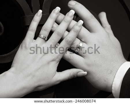 still life two hands with wedding rings - stock photo