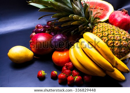 still life - various, assorted fruits on the black background
