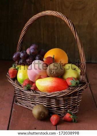 still life wicker basket with fruit on a wooden table