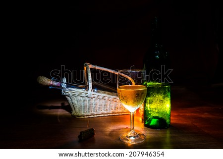 still life wine  and candle on dark. - stock photo