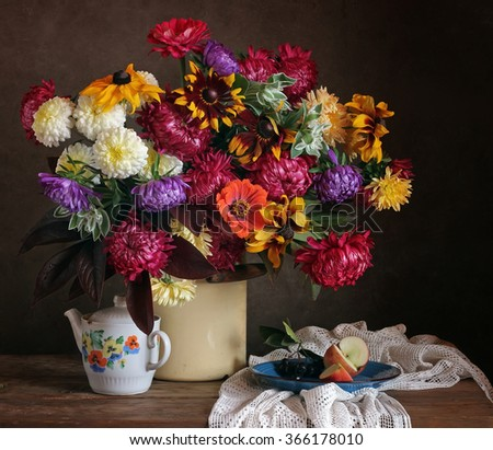 Still life with a beautiful bouquet of country flowers, apple and a retro teapot. - stock photo