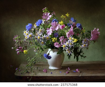 Still life with a beautiful bouquet of flowers - stock photo