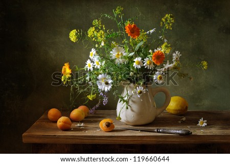 Still life with a beautiful bouquet of flowers and apricots - stock photo