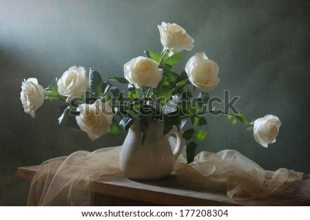 Still life with a beautiful bouquet of roses - stock photo