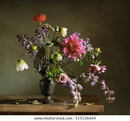 Still life with a beautiful bunch of autumn flowers - stock photo