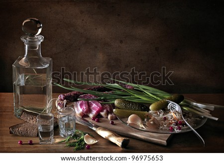 still life with a bottle, sausage and greens