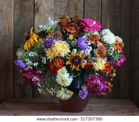 Still life with a bouquet of autumn flowers  - stock photo