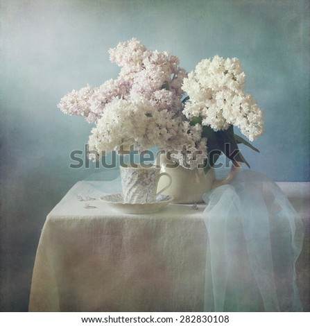 Still life with a bouquet of blooming lilacs (retro effect) - stock photo