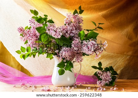 Still Life with a bouquet of lilacs - stock photo
