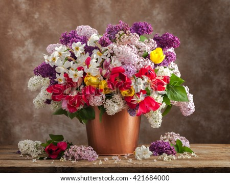 Still life with a bouquet of spring flower. - stock photo