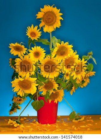 still life with a bouquet of sunflowers - stock photo