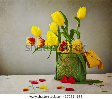 Still life with a bouquet of tulips and hearts - stock photo