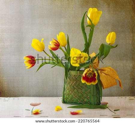 Still life with a bouquet of yellow tulips - stock photo