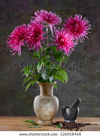 Still life with a bunch of asters  on a dark background - stock photo