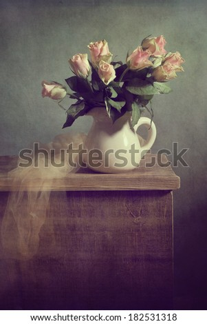 Still life with a bunch of roses isolated - stock photo