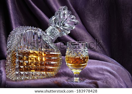 Still life with a crystal decanter and glass