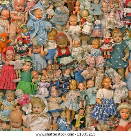 still life with a dolls collection - stock photo