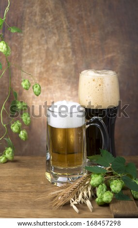 Still Life with a draft beer by the glass on wooden background