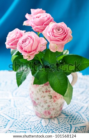 Still life with a fresh pink roses - stock photo