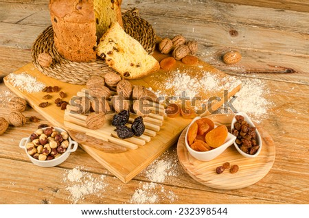 Still life with a homemade panettone and  ingredients - stock photo