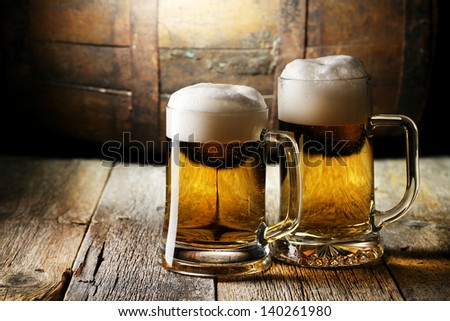 Still Life with a keg of beer and beer in the mug - stock photo