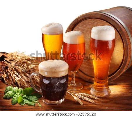 Still Life with a keg of beer and draft beer by the glass. Isolated on a white. - stock photo