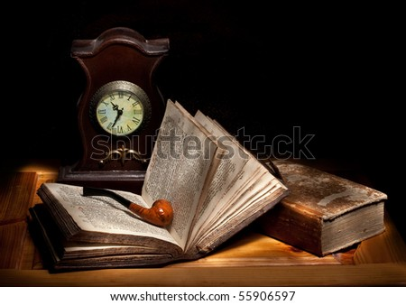 still life with a pipe, open bible and a clock - stock photo