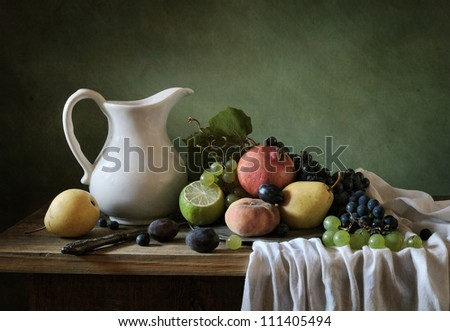 Still life with a plate full of fruit - stock photo