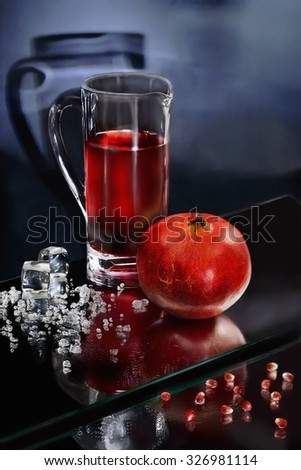 Still Life with a pomegranate juice and crushed ice.  Sharpness on the pomegranate and an ice crumb