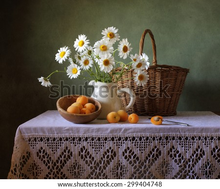 Still life with a summer bouquet and apricots - stock photo