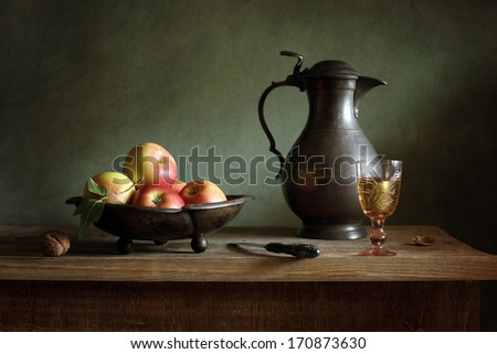 Still life with a tin jar and apples - stock photo