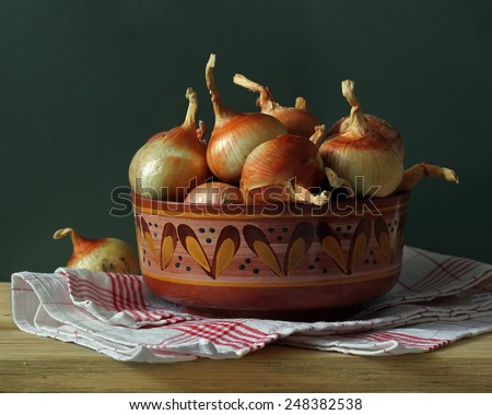 still life with a towel and onions - stock photo