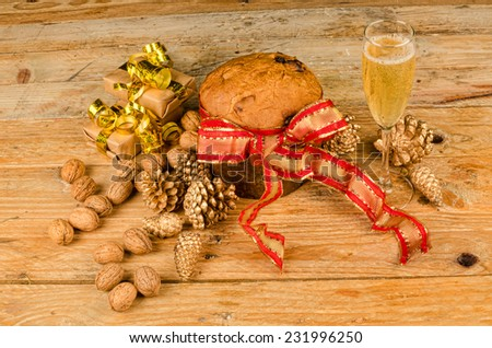 Still life with a traditional panettone in a festive setting - stock photo
