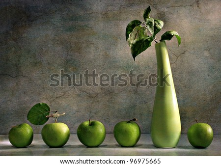 still life with a vase and a green apple - stock photo