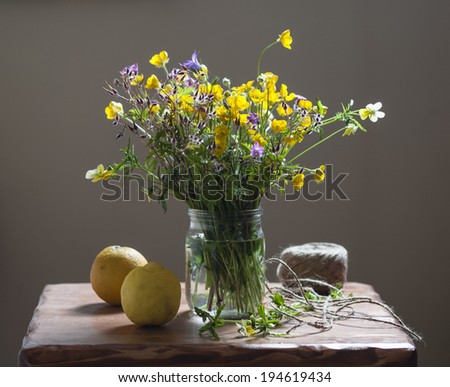 Still life with a voluptuous bunch of field flowers - stock photo