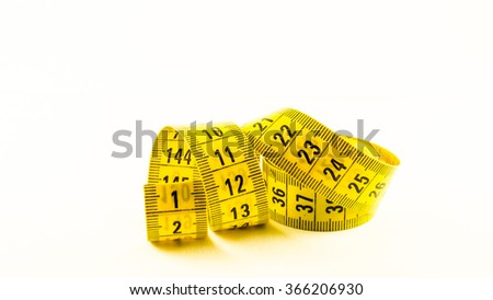 still life with a yellow tape measure, symbol of business, sizing, goal and diet