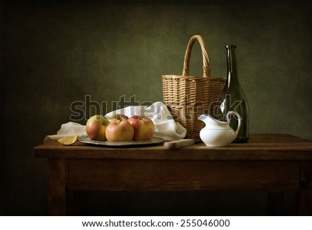 Still life with apples and a bottle of wine - stock photo