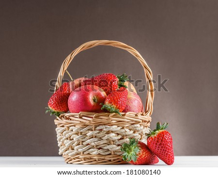 Still life with apples and strawberries - stock photo