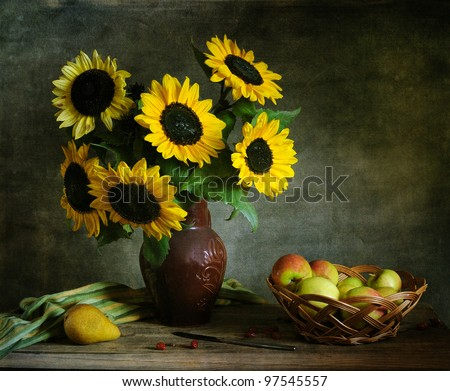 Still life with apples and sunflowers - stock photo